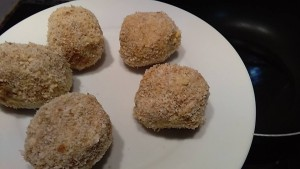 creating the stuffed olive ascolane and rolling them into breadcrumbs
